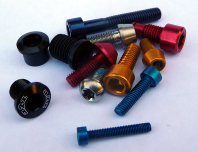 Close-up of a selection of titanium and aluminum bolts used in bicycle bolt tuning