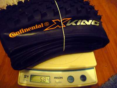 Continental X-King Racesport Tyre on scale weighing 586g