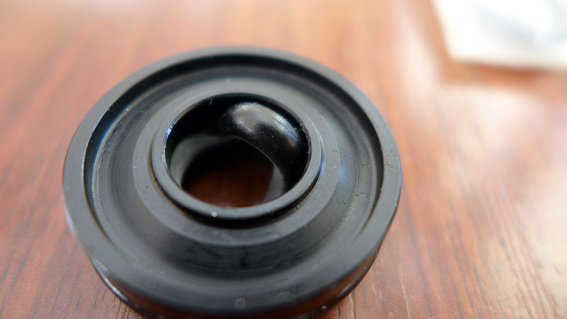 Rebound damper seal head